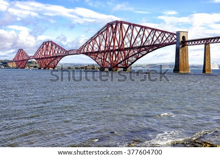 View of Forth Bridge, Scotland, UK. Fort Bridge is a cantilever railway bridge considered an iconic structure and a symbol of Scotland. It is a UNESCO World Heritage Site. - stock photo