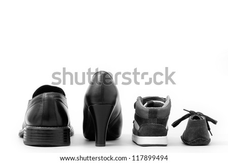 View of four isolated shoes (father, mother and two children). Concept of family - stock photo