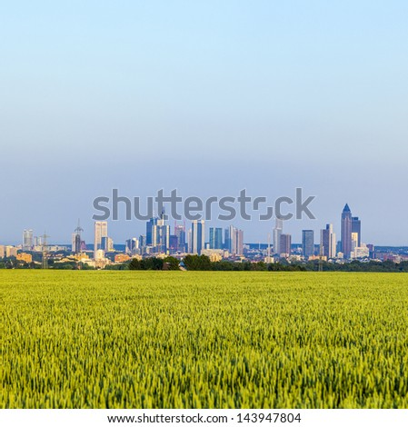 view of Frankfurt skyline with fields - stock photo