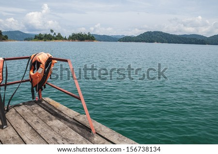 View of fresh water lake from the boat. - stock photo