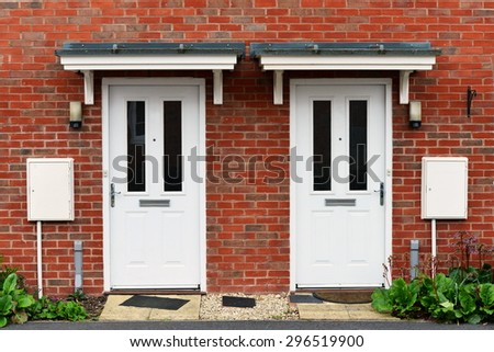 View of Front Doors of Two Neighbouring Red Brick English Town Houses on a Residential Estate