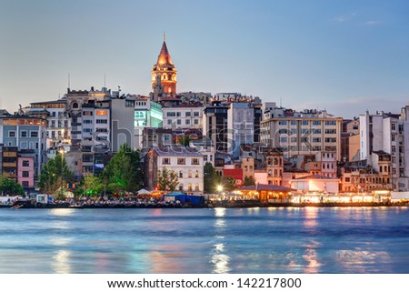 View of Galata district with Galata Tower at night, Istanbul, Turkey - stock photo
