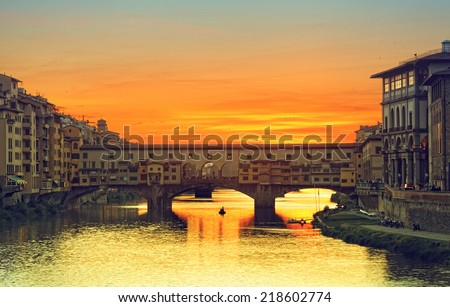 View of Gold (Ponte Vecchio) Bridge in Florence on a sunset - stock photo