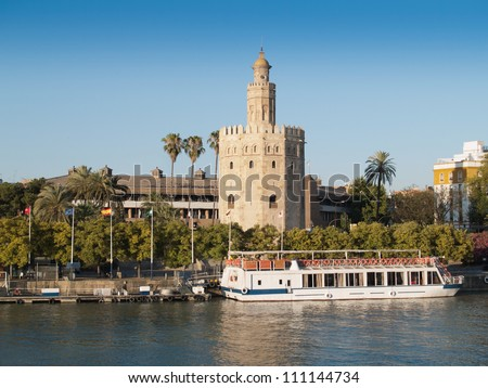 view of Golden Tower (Torre del Oro) of Seville, Andalusia, Spain over river Guadalquivir - stock photo