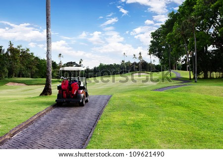 view of golf cart at golf course, <ali - stock photo