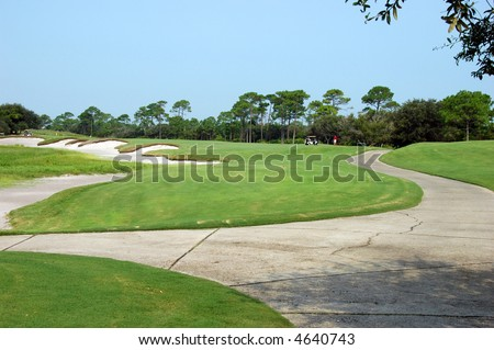 View of golf course with fairway and sand traps