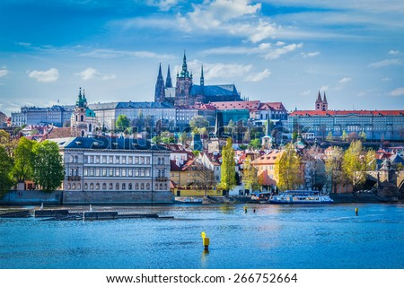 View of Gradchany (Prague Castle) and St. Vitus Cathedral in daytime over Vltava river - stock photo