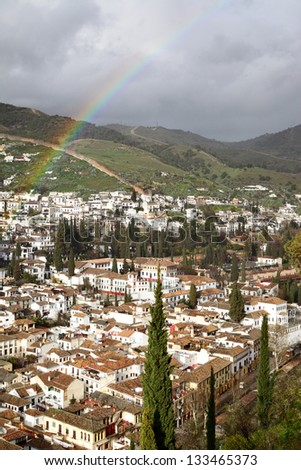 View of Granada after rain with rainbow, Spain