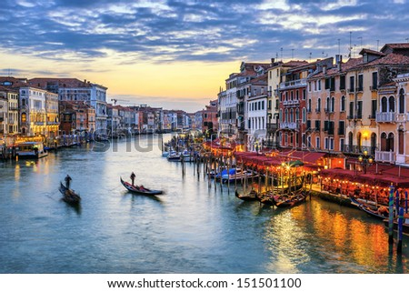 View of Grand Canal with gondolas at sunset in Venice - stock photo