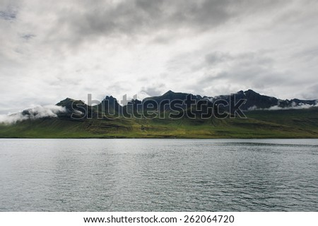 View of green hills, mountains and the sea in Westfjords, Iceland