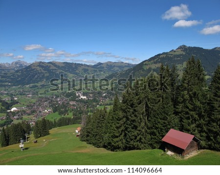 View Of Gstaad, Ski Lift In The Summer, Forest - stock photo