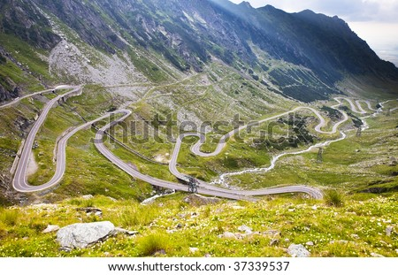 View of hairpin bend road in Fogaras mountains. Transfogarian Road in Romania.