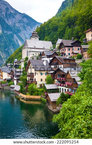 View of Hallstatt village with on lake shore and Alps behind, Austria - stock photo