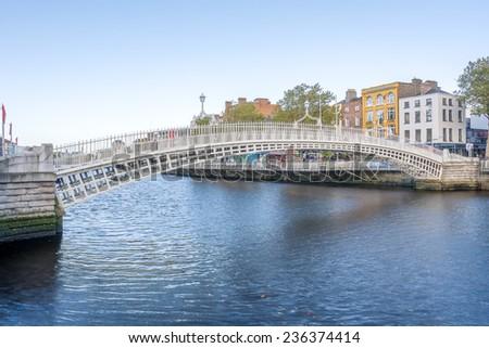 View of Hapenny Bridge over Liffey river in Dublin, Ireland - stock photo