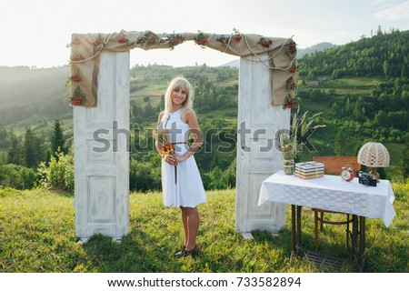 View of happy young couple near wedding wooden frame from doors standing outside in mountains background & Near Pair People Young Stock Images Royalty-Free Images u0026 Vectors ... pezcame.com