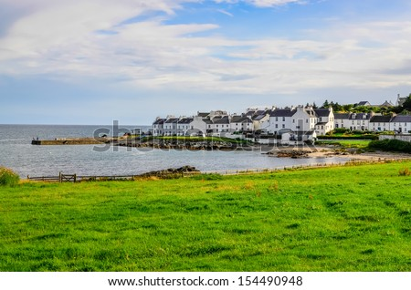 View of harbor and town Port Charlotte on Isle of Islay, Scotland - stock photo