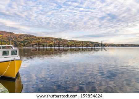 View of harbour with a boat  (Cape Breton, Nova Scotia, Canada) - stock photo