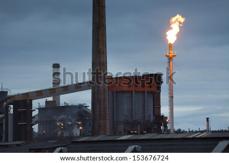 View of heavy industry at dawn in Asturias, North Spain. Smokestacks in factory at dawn. - stock photo