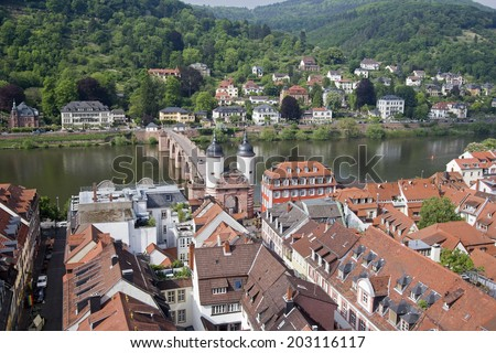 View of Heidelberg and the Old Bridge across the Neckar river in Germany from the church tower of the Heiliggeist church, church of the Holy Spirit