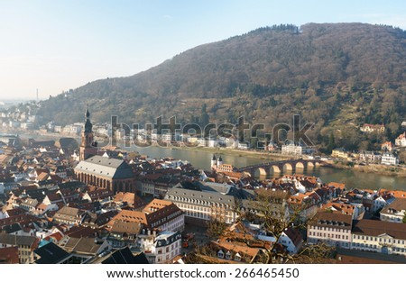 View of Heidelberg old town, Germany - Old Bridge, Church of the Holy Spirit - stock photo