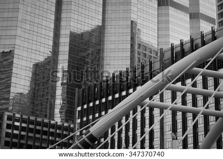 View of high buildings and public sky walk for transit between Sky Transit and Bus Rapid Transit Systems at Sathorn-Narathiwas junction - stock photo