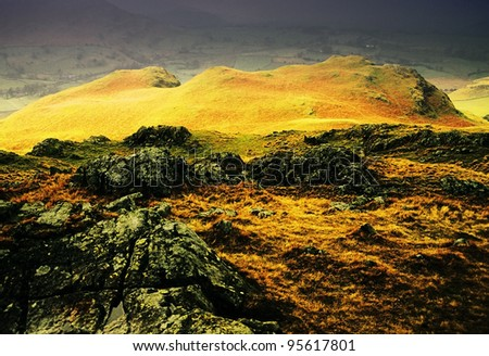 view of high rigg, st john in the vale, sunlight on hills after passing storm in the english lake district - stock photo