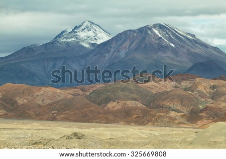View of high snow-capped mountain in Sico Pass, Chile - stock photo