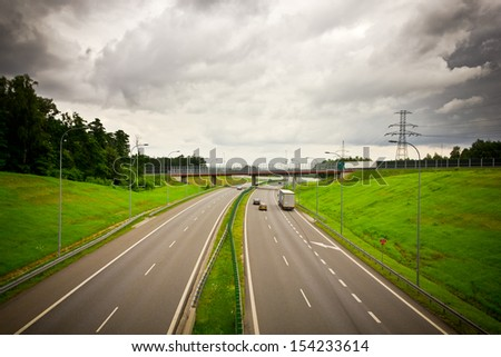View of highway on a cloudy day, Poland - stock photo