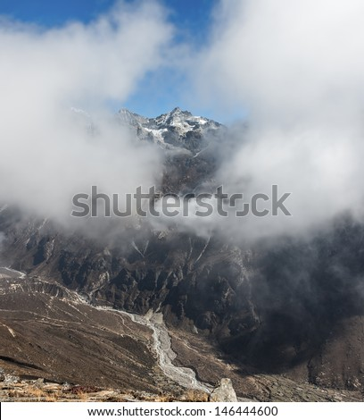 View of himalayan peaks in mist from Thame - Nepal, Himalayas