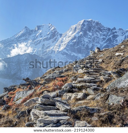 View of himalayan peaks in mist from the Sunder peak - Nepal, Himalayas - stock photo
