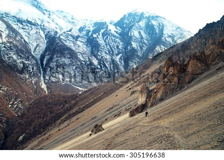 View of Himalayas mountains from Annapurna trek. Man standing on the path - stock photo