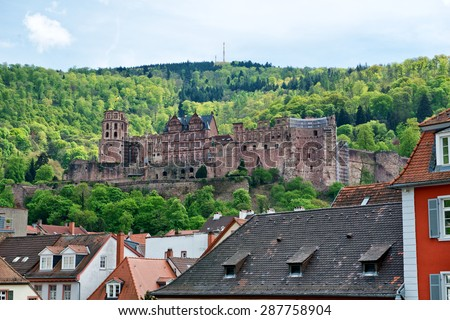 View of Historic Heidelberg Castle on Hill Overlooking Old Town Rooftops, Heidelberg, Baden-Wurttemberg, Germany - stock photo
