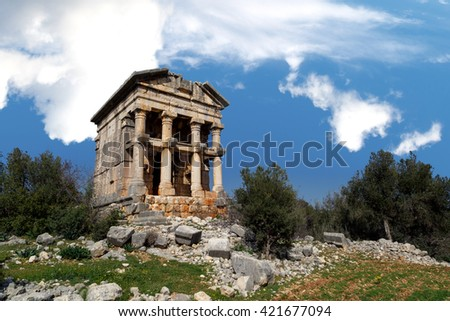 View of historical old Mezgit Castle in Mersin, on bright blue sky background. - stock photo