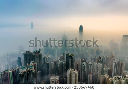 View of Hong Kong from Victoria peak in a foggy morning. - stock photo