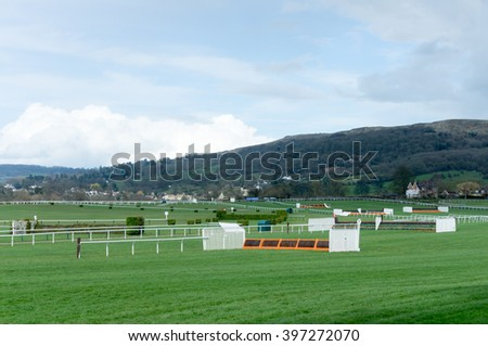 View of horse jump fences Cheltenham Racecourse.  - stock photo