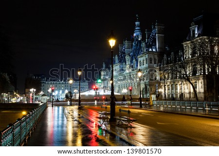 view of Hotel de Ville (City Hall) in Paris, France at rainy night