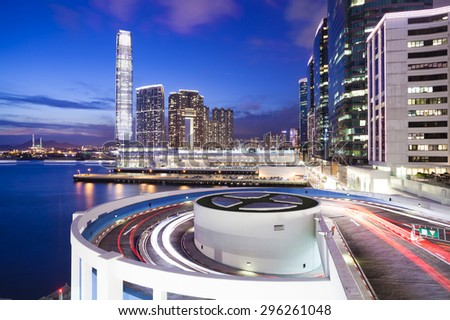 View of hotels, shopping mall and modern residential buildings in Hong Kong at night - stock photo