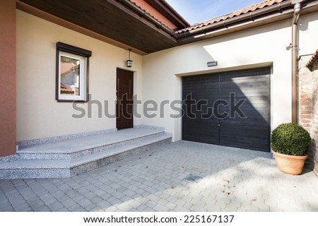 View of house entrance next to garage