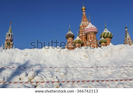 View of huge snowdrift on the background of Saint Basil's Church on the Red square in Moscow after a heavy snowfall, Russia