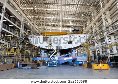 View of hull of a ship being built in a shipyard