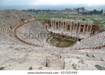 View of Hyerapolis Ancient City with a historical stone amphitheater. - stock photo