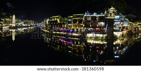 View of illuminated Wanming Pagoda in Fenghuang, China