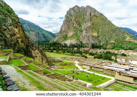 View of inca archaeological site with the Sun Temple on the mountain at Ollantaytambo in Peru
