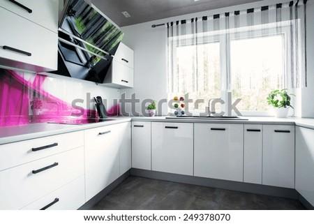 View of interior of bright white kitchen - stock photo