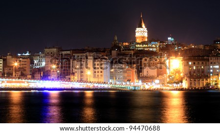 View of Istanbul and Galata tower and bridge at night - stock photo