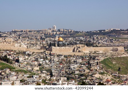 View of Jerusalem from a distance with the wall and the Dome of the Rock in view.