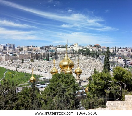 view of Jerusalem from the top of the Mount of Olives.Golden domes of the Church of Mary Magdalene, the old cemetery and the city wall - stock photo