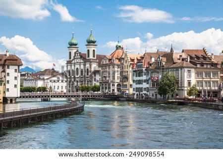 View of Jesuitenkirche (church) on the river side of Reuss, Lucerne, Switzerland - stock photo