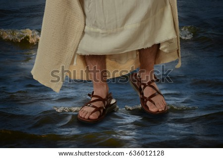 View of Jesus feet walking on the water
