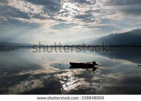 View of Kerkini lake with dramatic sky in Greece - stock photo